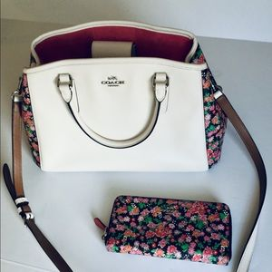Women's white and floral Coach Purse